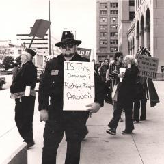 Paul Binkley & other Demonstrators in front of the GM building.  1980